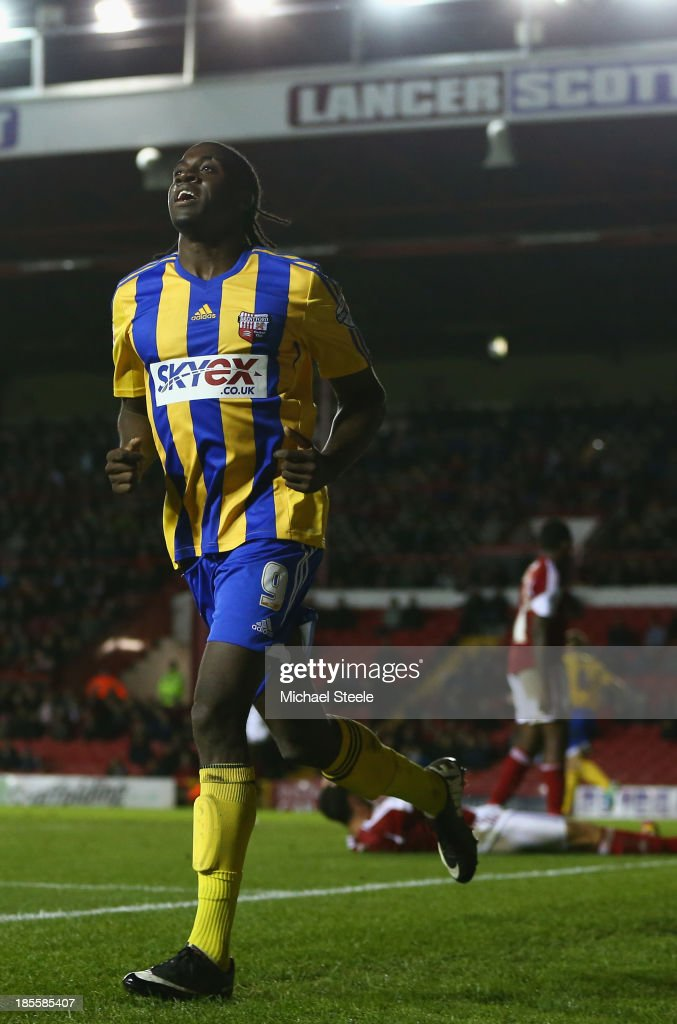 <a gi-track='captionPersonalityLinkClicked' href=/galleries/search?phrase=Clayton+Donaldson&family=editorial&specificpeople=4141597 ng-click='$event.stopPropagation()'>Clayton Donaldson</a> of Brentford celebrates scoring his sides second goal during the Sky Bet League One match between Bristol City and Brentford at Ashton Gate on October 22, 2013 in Bristol, England.