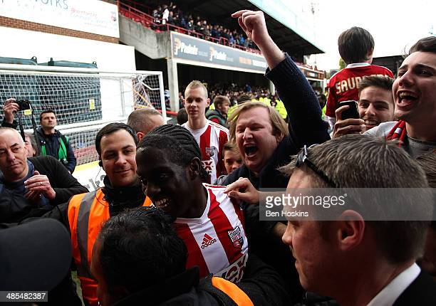 Clayton Donaldson of Brentford celebrates with fans after winning promotion during the Sky Bet League One match between Brentford and Preston North...