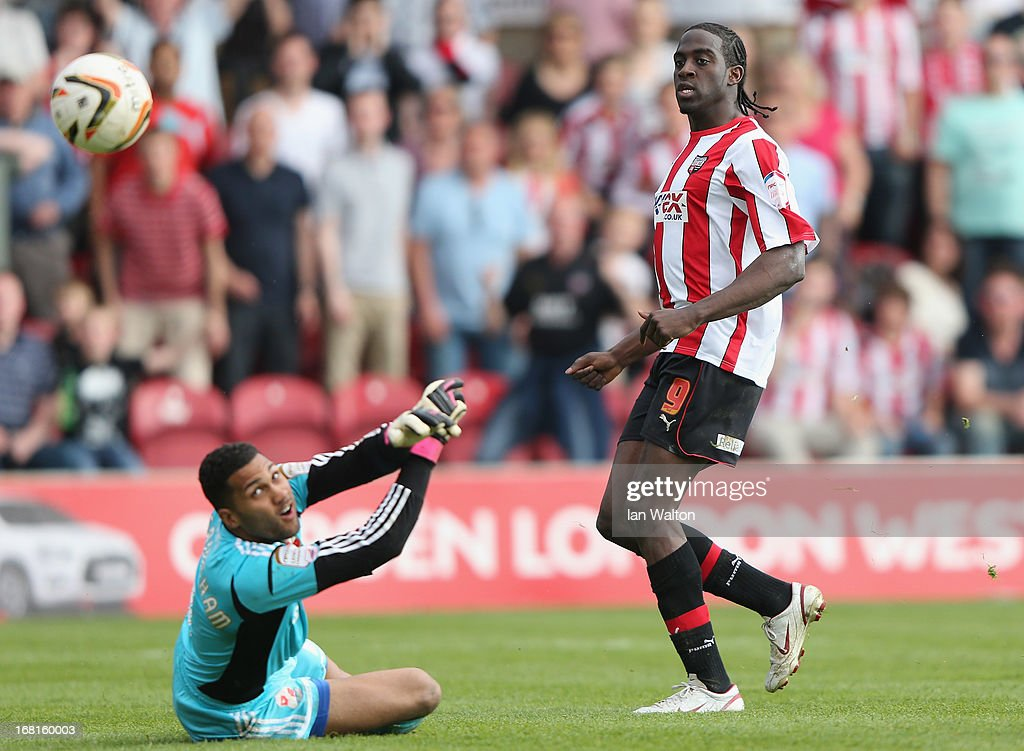 <a gi-track='captionPersonalityLinkClicked' href=/galleries/search?phrase=Clayton+Donaldson&family=editorial&specificpeople=4141597 ng-click='$event.stopPropagation()'>Clayton Donaldson</a> of Brentford scores his second goal during the npower League One Play Off Semi Final, Second Leg match between Brentford and Swindon Town at Griffin Park on May 6, 2013 in Brentford, England.