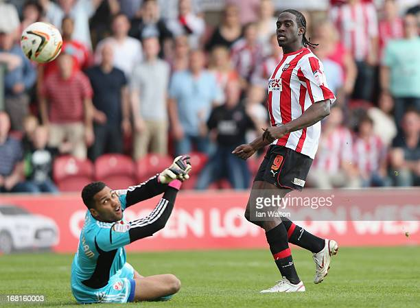 Clayton Donaldson of Brentford scores his second goal during the npower League One Play Off Semi Final Second Leg match between Brentford and Swindon...