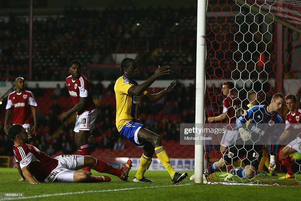 <a gi-track='captionPersonalityLinkClicked' href=/galleries/search?phrase=Clayton+Donaldson&family=editorial&specificpeople=4141597 ng-click='$event.stopPropagation()'>Clayton Donaldson</a> (C) of Brentford scories his sides second goal during the Sky Bet League One match between Bristol City and Brentford at Ashton Gate on October 22, 2013 in Bristol, England.