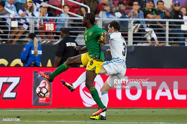 Clayton Donaldson of Jamaica and Diego Godin of Uruguay compete for the ball during a group C match between Uruguay and Jamaica at Levi's Stadium as...