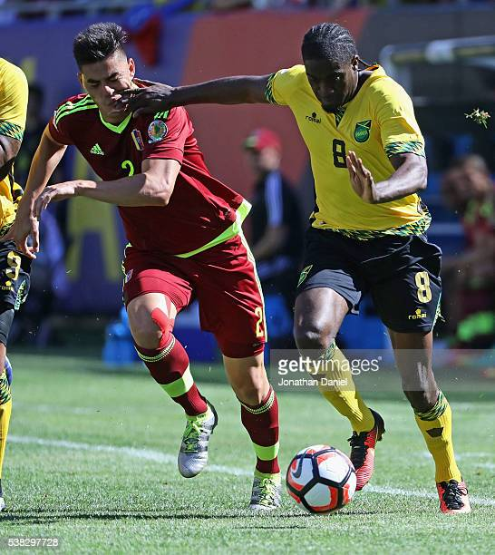 Clayton Donaldson of Jamaica hits Wuilker Angel of Venezuela in the face as they battle for the ball during a match in the 2016 Copa America...