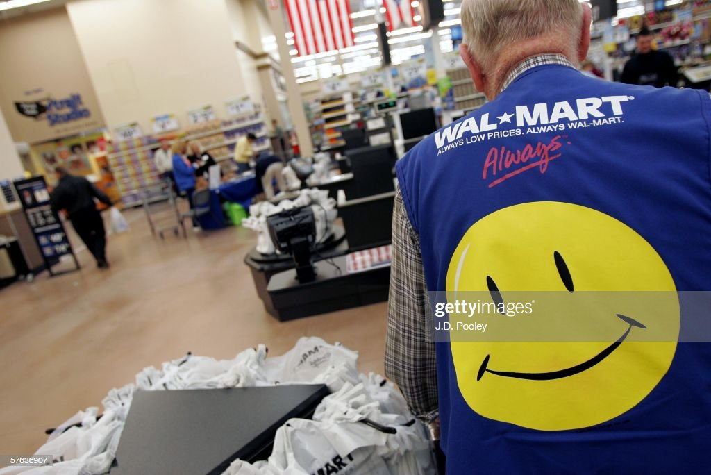 Clayton Fackler, 72, works at the checkout at the new 2,000 square foot Wal-Mart Supercenter store May 17, 2006 in Bowling Green, Ohio. The new store, one of three new supercenters opening today in Ohio, employs 340 people with 60 percent of those working full-time.
