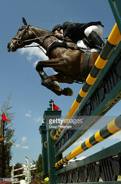 Clayton Fredericks of Australia and haling from Little Chevreu Great Britain atop Ben Along Time competes in the Stadium Jumping Phase as he won the...