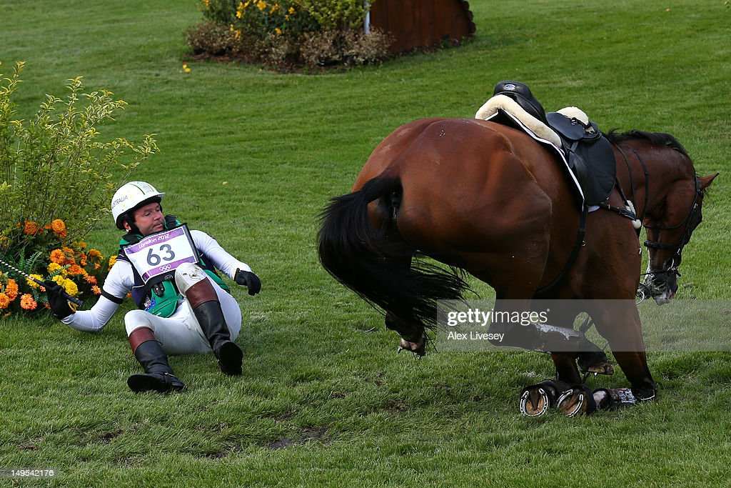 <a gi-track='captionPersonalityLinkClicked' href=/galleries/search?phrase=Clayton+Fredericks&family=editorial&specificpeople=1295826 ng-click='$event.stopPropagation()'>Clayton Fredericks</a> of Australia falls from Bendigo in the Eventing Cross Country Equestrian event on Day 3 of the London 2012 Olympic Games at Greenwich Park on July 30, 2012 in London, England.