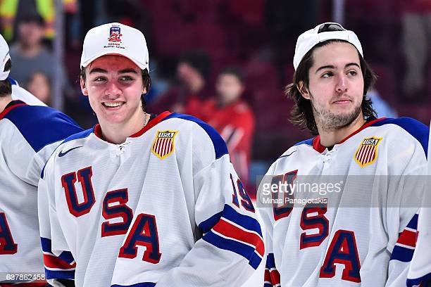 Clayton Keller and teammate Jeremy Bracco of Team United States react after wining the gold medal round during the 2017 IIHF World Junior...