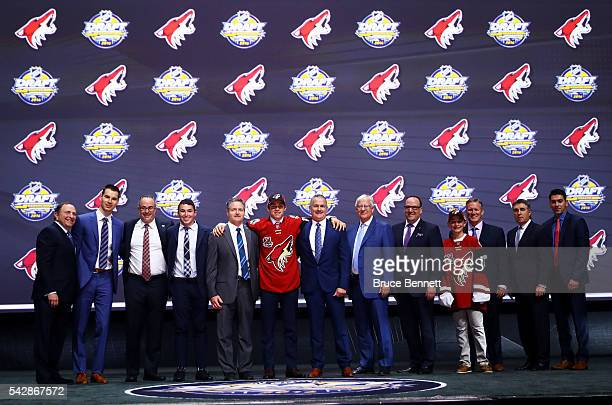 Clayton Keller celebrates with the Arizona Coyotes after being selected seventh overall during round one of the 2016 NHL Draft on June 24 2016 in...