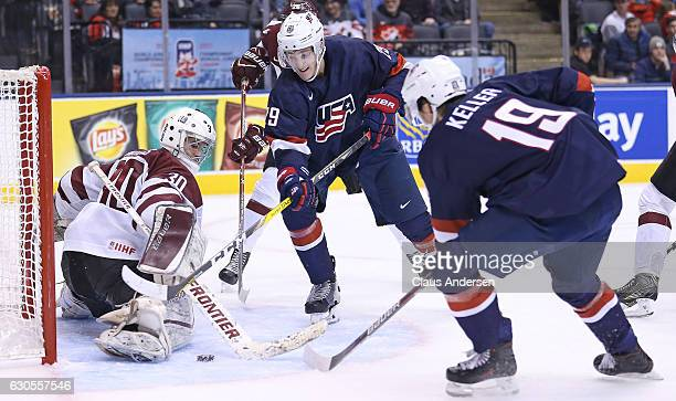 Clayton Keller of Team USA gets set to put a puck past Mareks Mitens of Team Latvia during a 2017 IIHF World Junior Hockey Championship game at the...