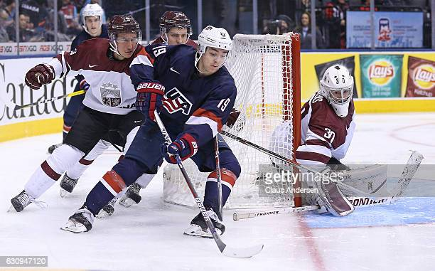 Clayton Keller of Team USA skates with the puck against Team Latvia during a preliminary game at the 2017 IIHF World Junior Hockey Championship at...
