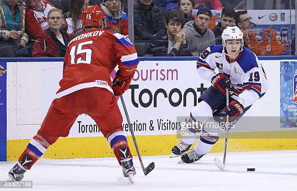 Clayton Keller of Team USA skates with the puck against Team Russia during a preliminary game at the 2017 IIHF World Junior Hockey Championship at...