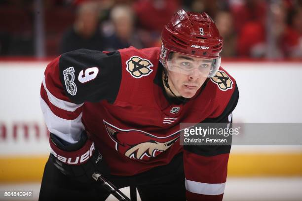 Clayton Keller of the Arizona Coyotes awaits a face off against the Chicago Blackhawks during the third period of the NHL game at Gila River Arena on...