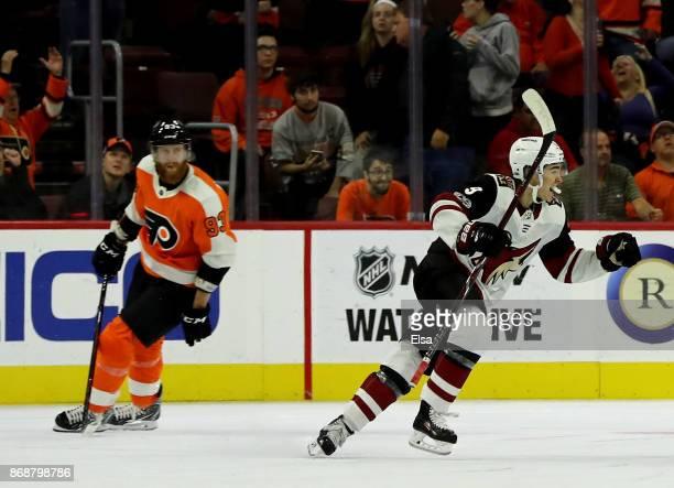 Clayton Keller of the Arizona Coyotes celebrates teammate Alex Goligoski's game winning goal as Jakub Voracek of the Philadelphia Flyers reacts in...