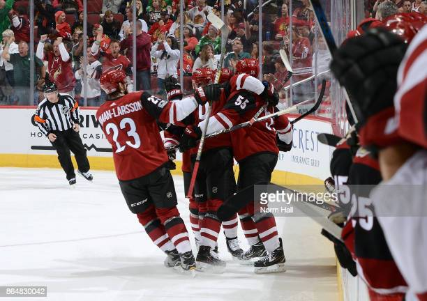 Clayton Keller of the Arizona Coyotes celebrates with Oliver EkmanLarsson Jason Demers and teammates after scoring a second period goal against the...