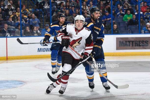Clayton Keller of the Arizona Coyotes skates against Robert Bortuzzo of the St Louis Blues on March 27 2017 at Scottrade Center in St Louis Missouri