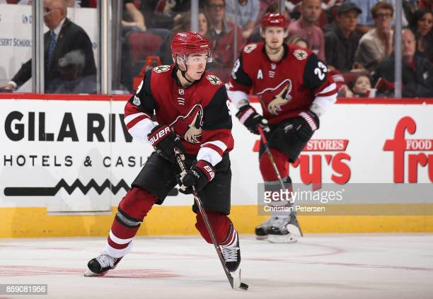 Clayton Keller of the Arizona Coyotes skates with the puck ahead of Oliver EkmanLarsson during the second period of the NHL game against the Vegas...