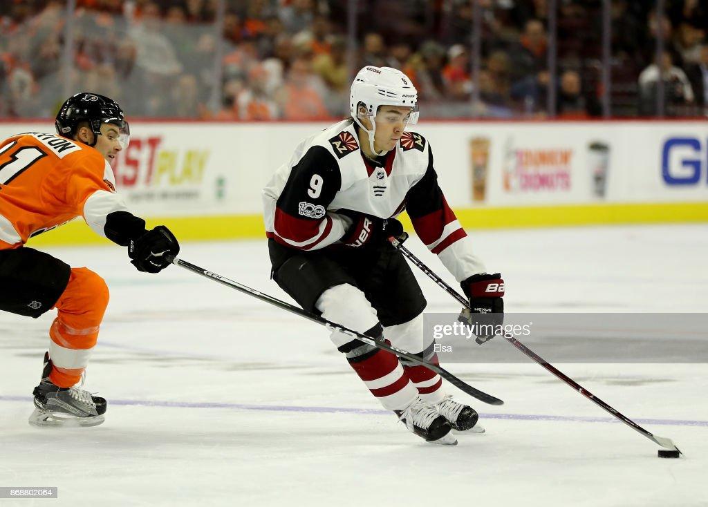 Clayton Keller #9 of the Arizona Coyotes takes the puck as Scott Laughton #21 of the Philadelphia Flyers defends on October 30, 2017 at Wells Fargo Center in Philadelphia, Pennsylvania.