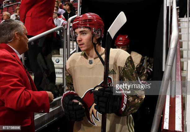 Clayton Keller of the Arizona Coyotes walks to the ice for pregame in a military style jersey for military night during a game against the Winnipeg...