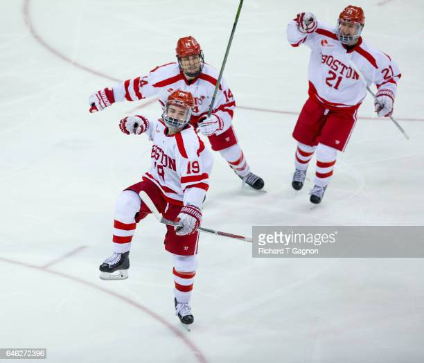Clayton Keller of the Boston University Terriers celebrates his first of two goals against the Notre Dame Fighting Irish with his teammates Bobo...