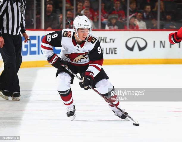 Clayton Keller of the Ottawa Senators plays the puck during the game against the New Jersey Devils at Prudential Center on October 27 2017 in Newark...