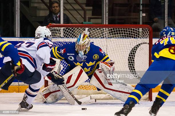 Clayton Keller of the United States moves the puck against Filip Gustavsson of Sweden during semifinals at the World Under17 Hockey Challenge on...