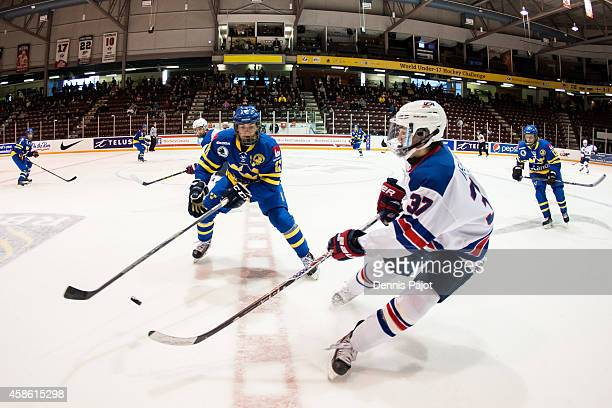 Clayton Keller of the United States moves the puck against William Fallstrom of Sweden during semifinals at the World Under17 Hockey Challenge on...