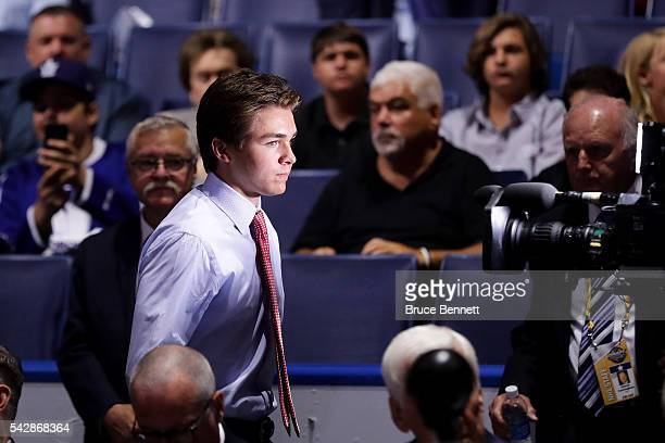 Clayton Keller reacts after being selected seventh overall by the Arizona Coyotes during round one of the 2016 NHL Draft on June 24 2016 in Buffalo...