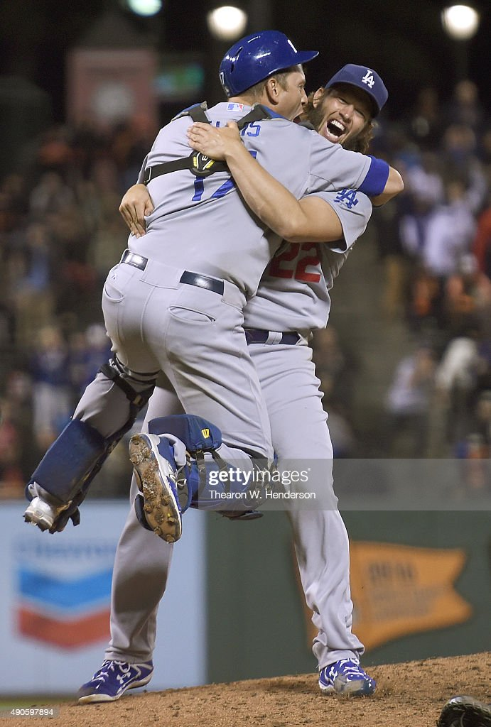 Clayton Kershaw and AJ Ellis of the Los Angeles Dodgers celebrates defeating the San Francisco Giants 80 to clinch the National League West at ATT...