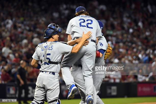 Clayton Kershaw Kenley Jansen and Austin Barnes of the Los Angeles Dodgers celebrate after the Dodgers defeated the Arizona Diamondbacks in Game 3 of...