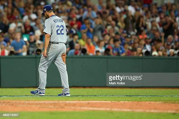Clayton Kershaw of the Dodgers leaves the field after being pulled during the opening match of the MLB season between the Los Angeles Dodgers and the...