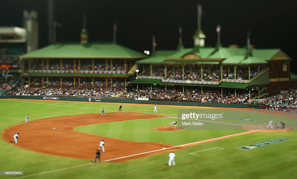 Clayton Kershaw of the Dodgers pitches to Aaron Hill of the Diamondbacks during the opening match of the MLB season between the Los Angeles Dodgers and the Arizona Diamondbacks at Sydney Cricket Ground on March 22, 2014 in Sydney, Australia.
