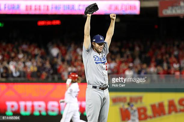 Clayton Kershaw of the Los Angeles Dodgers celebrates after winning game five of the National League Division Series over the Washington Nationals 43...