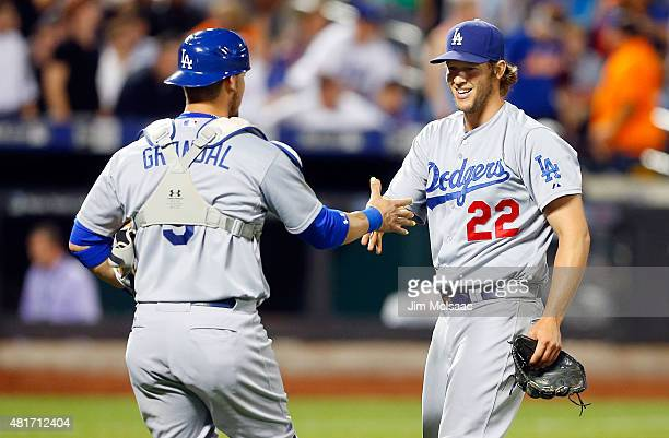 Clayton Kershaw of the Los Angeles Dodgers celebrates his 30 shutout against the New York Mets with teammate Yasmani Grandal at Citi Field on July 23...