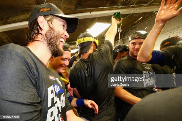 Clayton Kershaw of the Los Angeles Dodgers celebrates in the clubhouse after defeating the Chicago Cubs 111 in game five of the National League...
