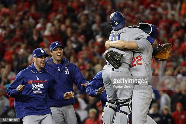 Clayton Kershaw of the Los Angeles Dodgers celebrates with teammate Carlos Ruiz after winning game five of the National League Division Series over...