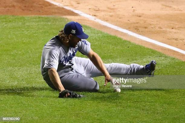 Clayton Kershaw of the Los Angeles Dodgers fields a bunt in the sixth inning against the Chicago Cubs during game five of the National League...