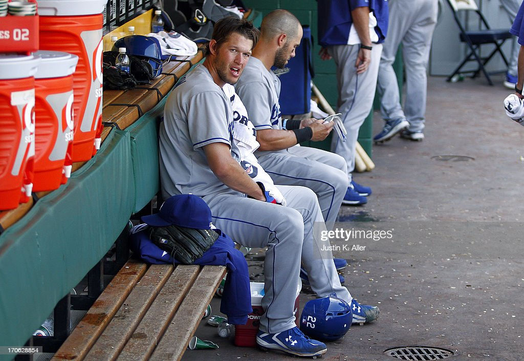 Clayton Kershaw #22 of the Los Angeles Dodgers looks on from the dugout against the Pittsburgh Pirates during the game on June 15, 2013 at PNC Park in Pittsburgh, Pennsylvania.