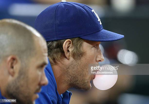 Clayton Kershaw of the Los Angeles Dodgers looks on while blowing a bubble during MLB game action against the Toronto Blue Jays on July 23 2013 at...