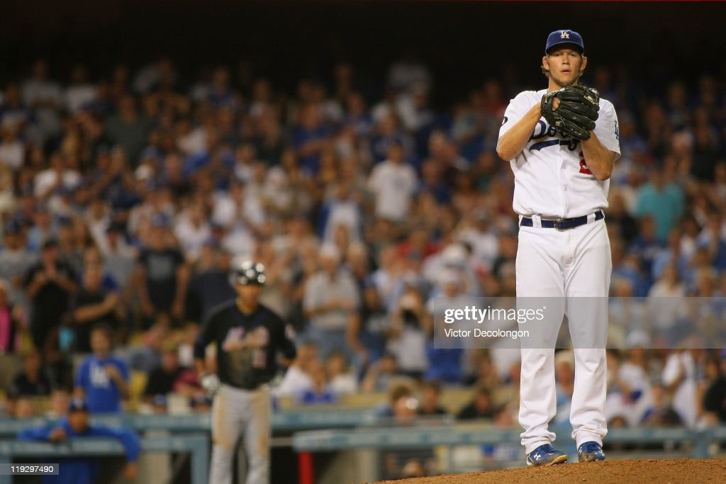 <a gi-track='captionPersonalityLinkClicked' href=/galleries/search?phrase=Clayton+Kershaw&family=editorial&specificpeople=4391635 ng-click='$event.stopPropagation()'>Clayton Kershaw</a> #22 of the Los Angeles Dodgers pauses as the fans stand and applaud before going into his wind up in the eighth inning during the MLB game against the New York Mets at Dodger Stadium on July 7, 2011 in Los Angeles, California. The Dodgers defeated the Mets 6-0.