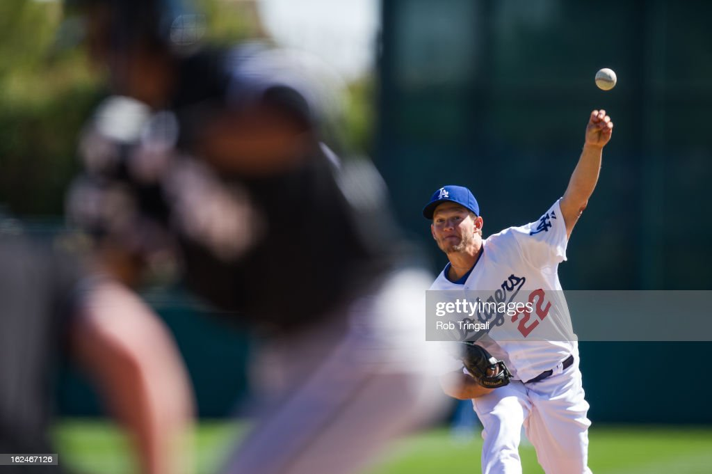 <a gi-track='captionPersonalityLinkClicked' href=/galleries/search?phrase=Clayton+Kershaw&family=editorial&specificpeople=4391635 ng-click='$event.stopPropagation()'>Clayton Kershaw</a> #22 of the Los Angeles Dodgers pitches during a spring training game against the Chicago White Sox at Camelback Ranch on February 23, 2013 in Glendale, Arizona.
