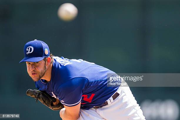 Clayton Kershaw of the Los Angeles Dodgers pitches during a spring training game against the Chicago White Sox at Camelback Ranch on March 3 2016 in...