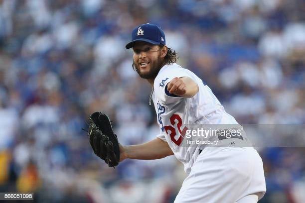 Clayton Kershaw of the Los Angeles Dodgers pitches during the first inning against the Houston Astros in game one of the 2017 World Series at Dodger...