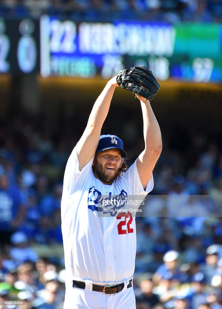 Clayton Kershaw #22 of the Los Angeles Dodgers pitches from the stretch in the seventh inning of the game against the San Francisco Giants at Dodger Stadium on September 24, 2017 in Los Angeles, California.