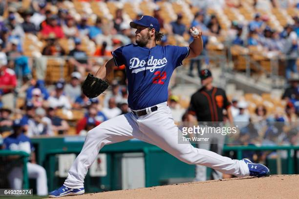 Clayton Kershaw of the Los Angeles Dodgers pitches to the San Francisco Giants in the first inning during the spring training game at Camelback Ranch...