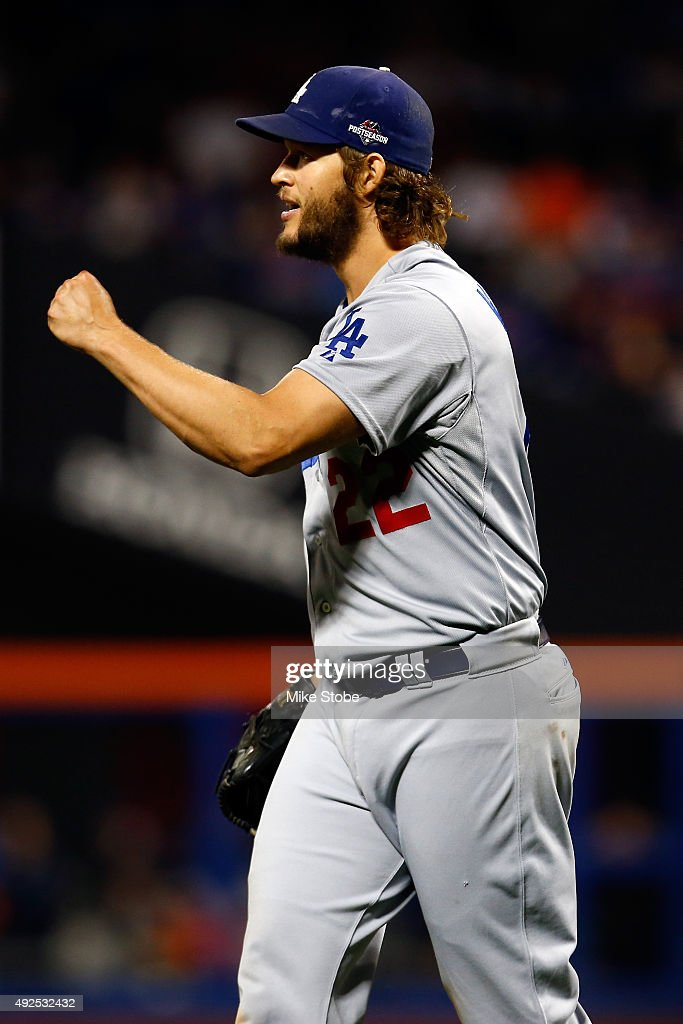 Clayton Kershaw #22 of the Los Angeles Dodgers react after closing out the seventh inning against the New York Mets during game four of the National League Division Series at Citi Field on October 13, 2015 in New York City.