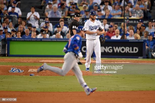 Clayton Kershaw of the Los Angeles Dodgers reacts after giving up a two run home run hits a by Albert Almora Jr #5 of the Chicago Cubs during the...