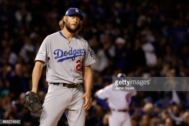 Clayton Kershaw of the Los Angeles Dodgers reacts after giving up a walk in the first inning against the Chicago Cubs during game five of the...