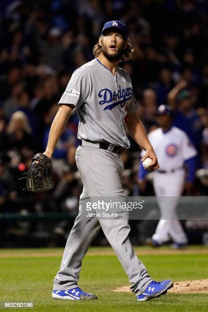 Clayton Kershaw of the Los Angeles Dodgers reacts after giving up a home run in the fourth inning against the Chicago Cubs during game five of the...