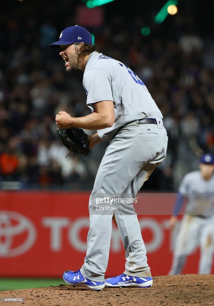 Clayton Kershaw #22 of the Los Angeles Dodgers reacts after he struck out Tim Federowicz #43 of the San Francisco Giants with the bases loaded to end the sixth inning at AT&T Park on September 12, 2017 in San Francisco, California.