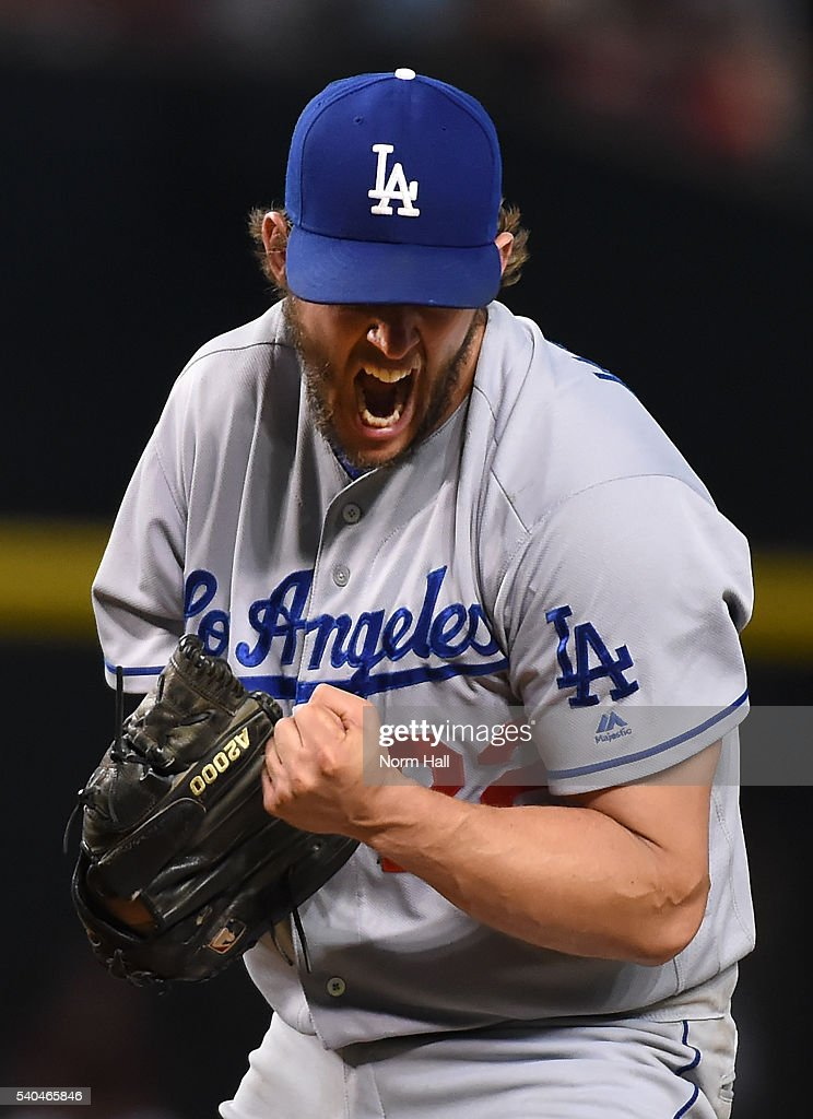 Clayton Kershaw of the Los Angeles Dodgers reacts after striking out Nick Ahmed of the Arizona Diamondbacks during the seventh inning at Chase Field...